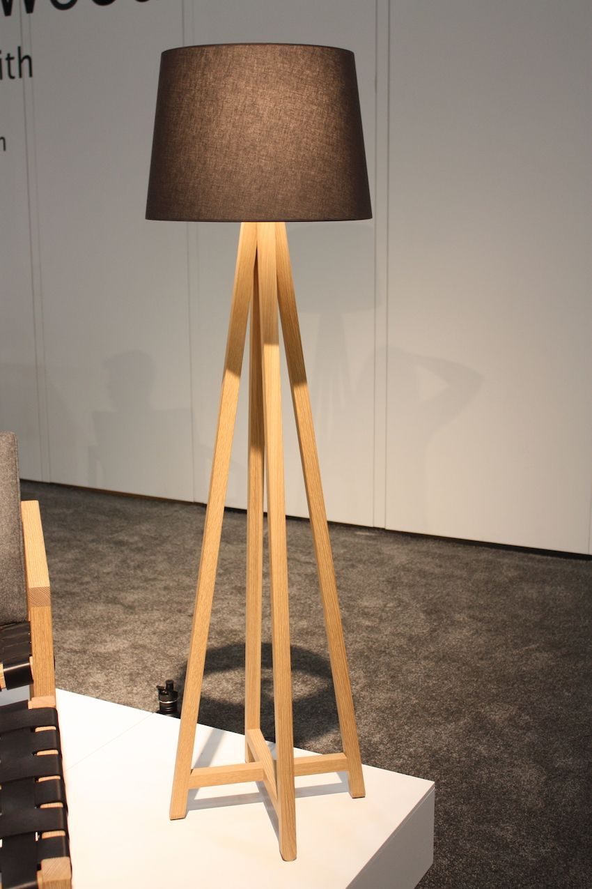 Another elegant wooden floor lamp is from Canada's Christopher Solar Design. Available in white oak or black ash, the The Alpha floor lamp has tall, tapered legs making up its wooden base . The large drum shade tops off the piece, making for a clean and elegant fixture.