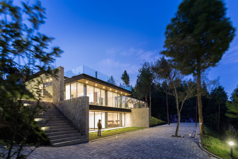 A Modern Glass Extension Built For An Adobe House