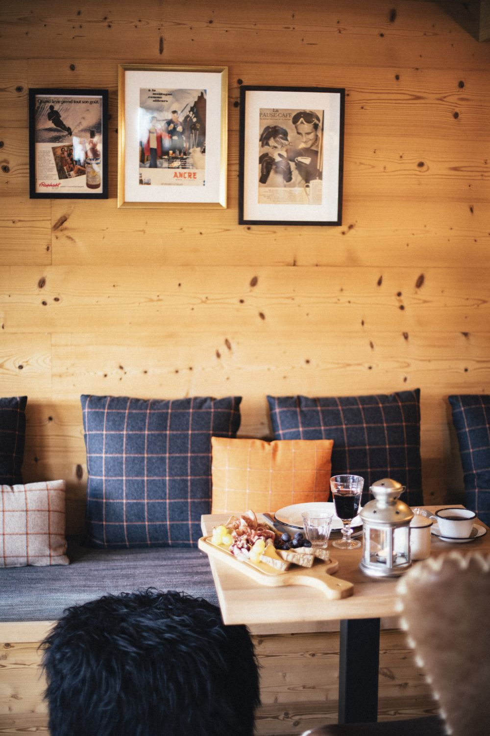 The restaurants feature comfortable wood benches with cozy cushions and pillows and walls decorated with framed pictures