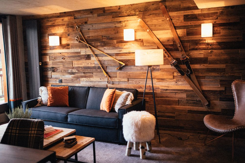 The wood-paneled walls give the space a chalet-like, rustic appearance