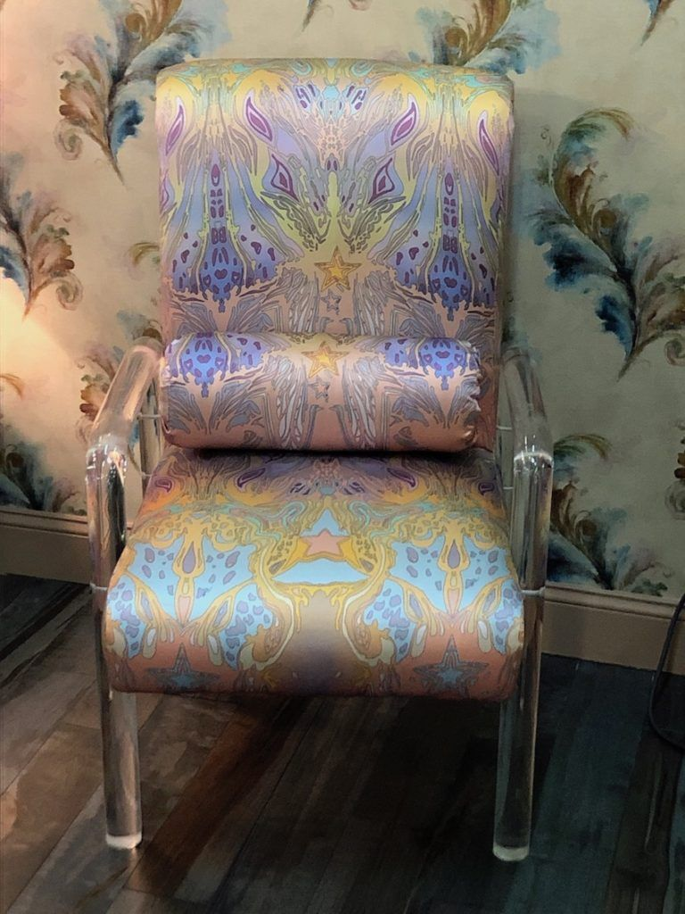 Lucite and a fantastical pastel textile create a very feminine chair.
